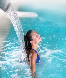 Spa hydrotherapy woman waterfall jet