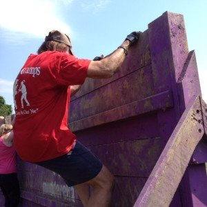 Ken climbing the wall at The Mudderella in Clarksburg, Maryland.